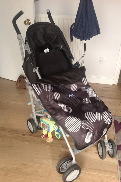 a babies buggy with footmuff and parasol