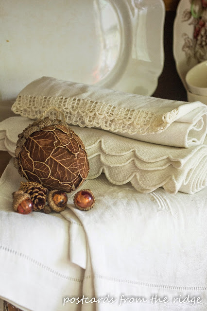 old white hand towels with glass acorns and fall decor