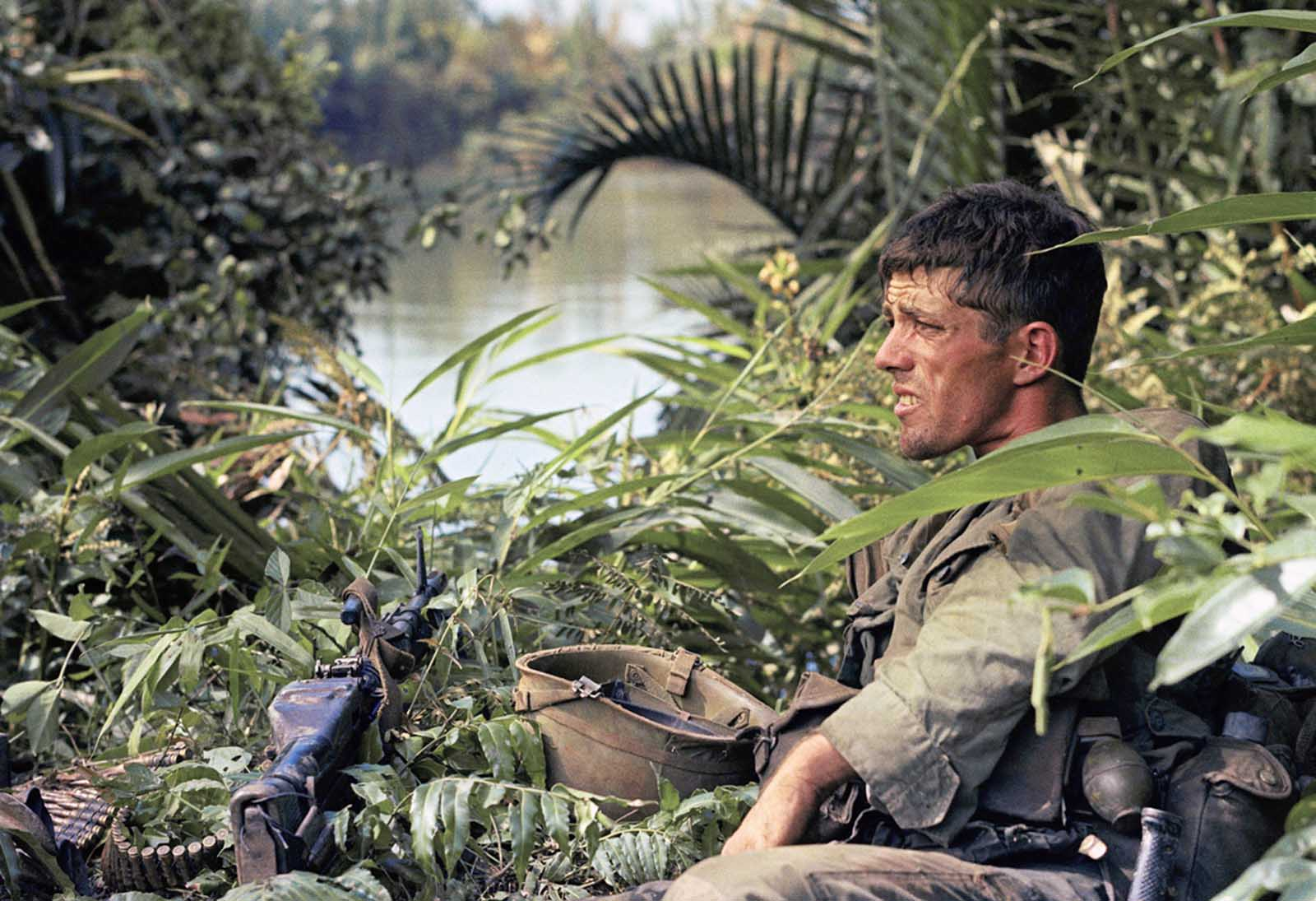 Rick Holmes of C company, 2nd battalion, 503rd infantry, 173rd airborne brigade, sits down on January 3, 1966, in Vietnam.