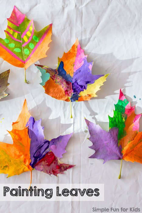 oak leaves painted different vibrant colors.