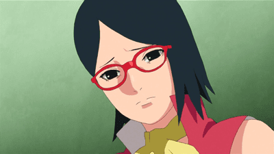 Sarada observando la foto de Karin.