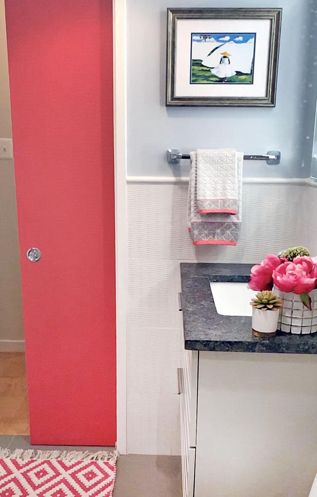 Fuchsia pocket door in white and gray bath
