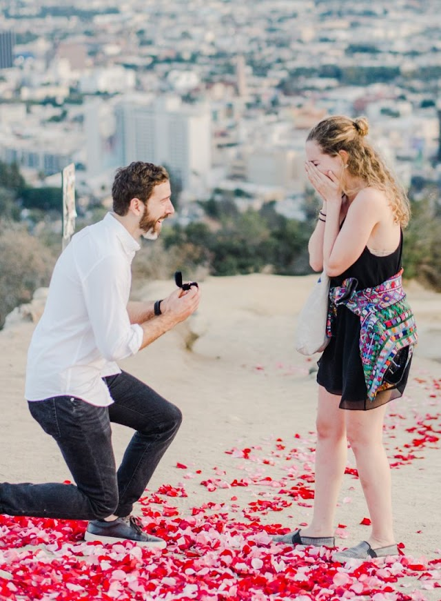 Young Man Proposes To Girlfriend With 16 Dogs! (Photos)