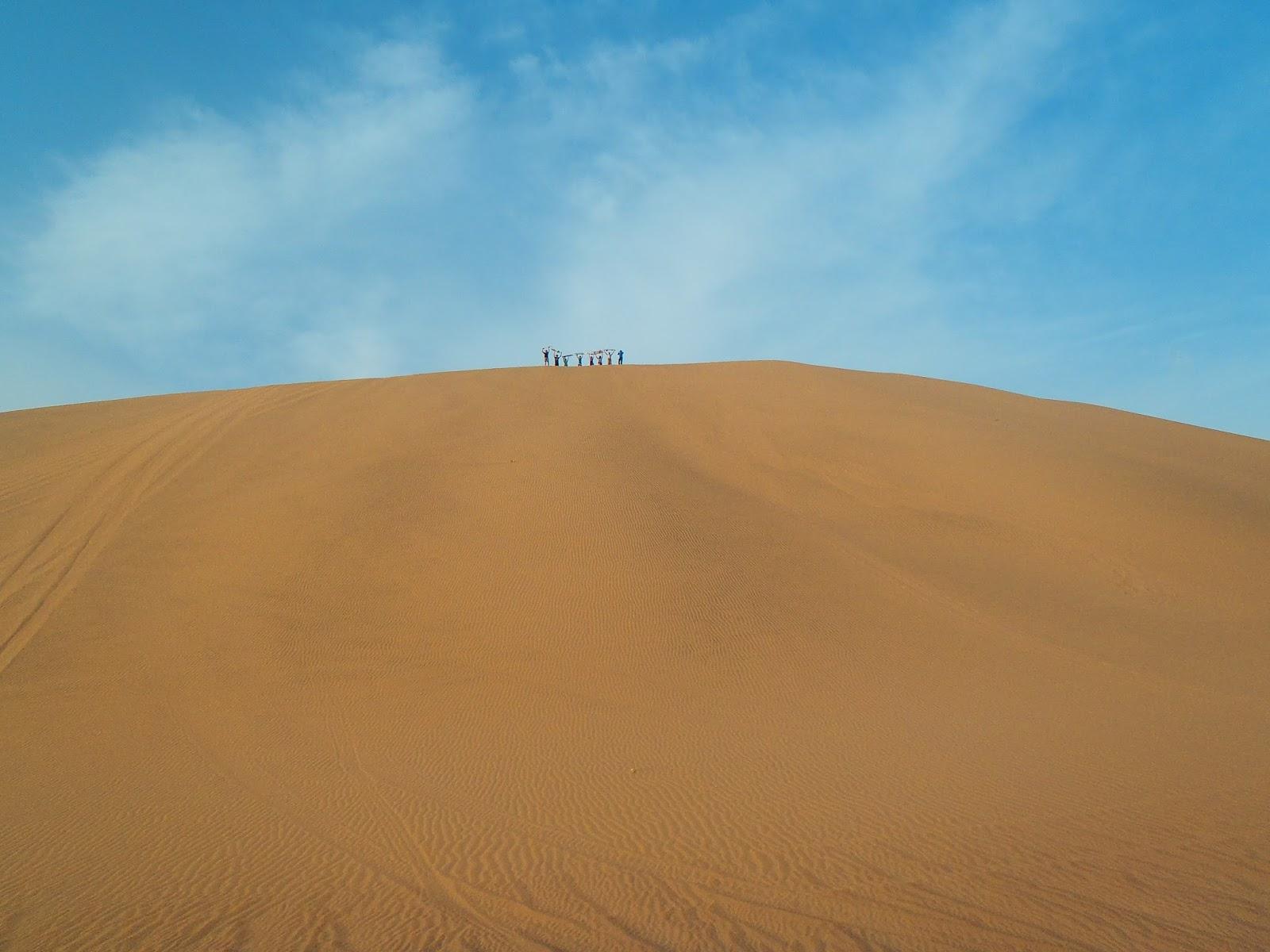 Group sandboarding in Peru