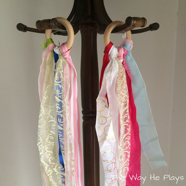 Full length of two ribbon rings hanging from hooks