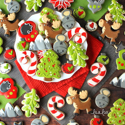 Brightly colored and fun Christmas sugar cookies - mistletoe, moose, ornaments and candy canes!