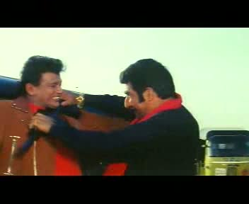 Bulla chokes Shankar with a rifle