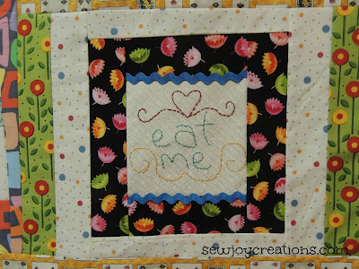 handstitch quilt block with ric rac on alice in wonderland quilt