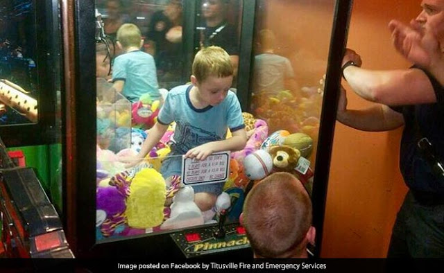 When the toy machine was caught in a four year old and picked up the favorite toy ...