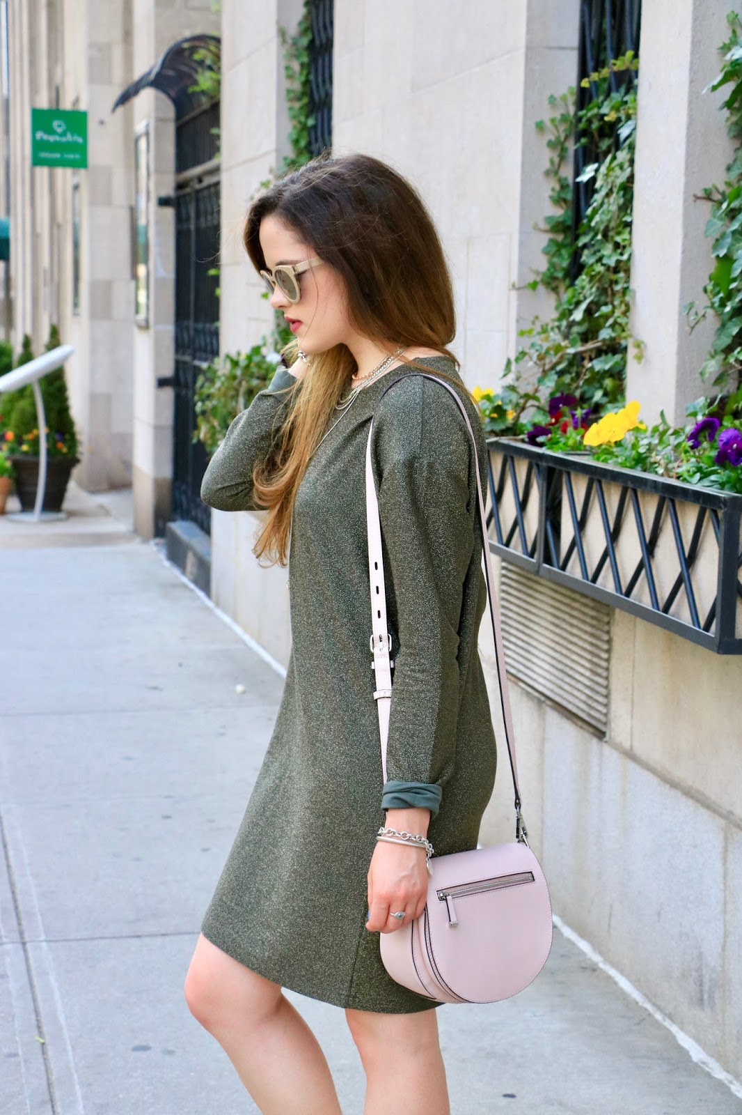 Fashion blogger Kathleen Harper wearing green sparkly sweater dress