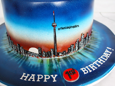 hand painted edible toronto skyline cake