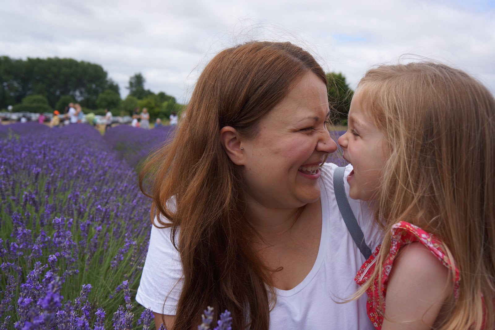 mum and daughter at a lavender field laughing