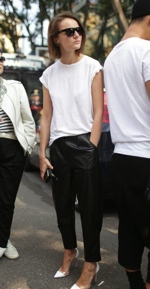 a girl wearing leather pants and white t-shirt with white stiletos