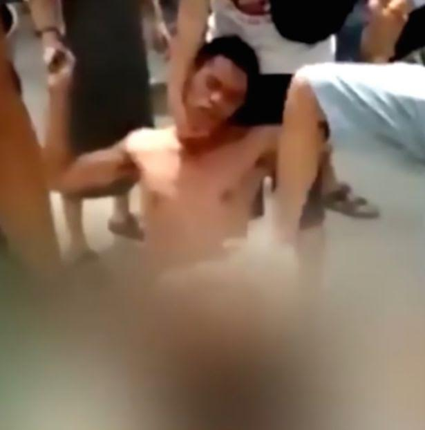 dude-stripped-by-crowd-abused-amature-hard