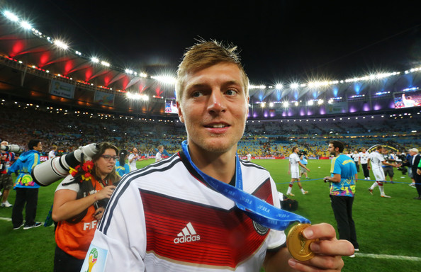 Toni Kroos of Germany celebrates with his medal after defeating Argentina 1-0 in extra time during the 2014 FIFA World Cup Brazil Final match between Germany and Argentina at Maracana on July 13, 2014 in Rio de Janeiro, Brazil