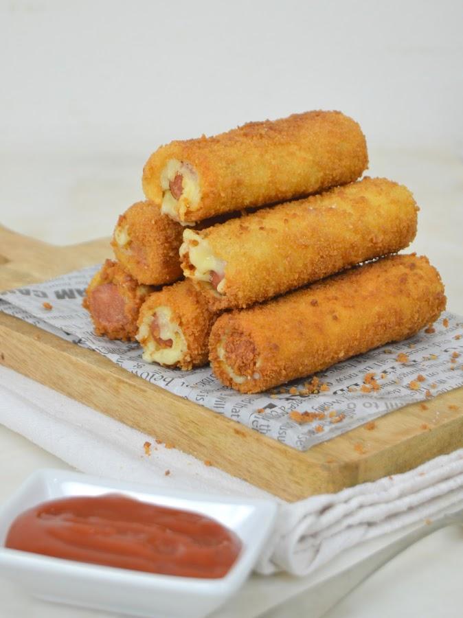Rollitos de salchicha y queso con pan de molde