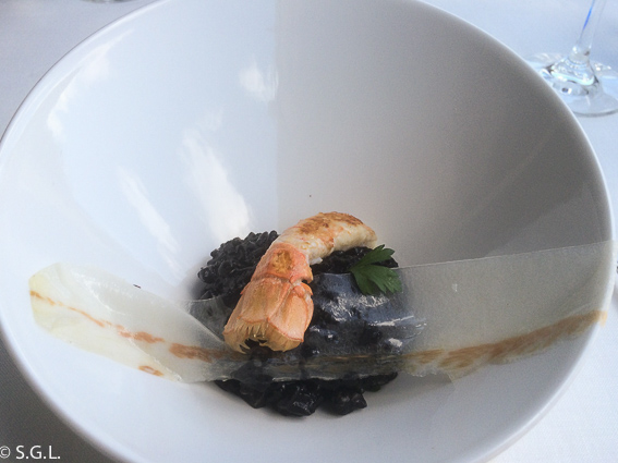 Restaurante Baita Gaminiz. Arroz de txipi en su tinta con cigalas y papada. Bilbao