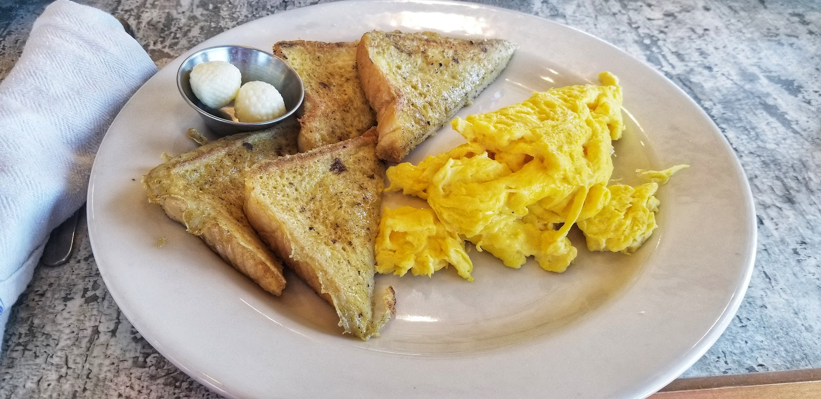 French Toast and Scrambled Eggs with Cheese at Huey's Southern Eats