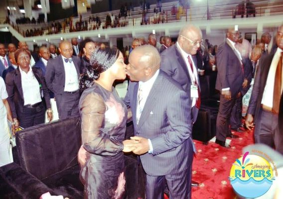 Photo of Governor Wike and wife kissing at the NBA Conference