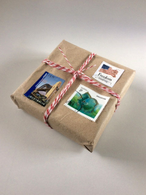 gift wrapping with twine, kraft paper, postage stamps, brown paper packages tied up with string, blah to TADA!
