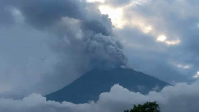 Mount Agung erupts with a blast of ash.