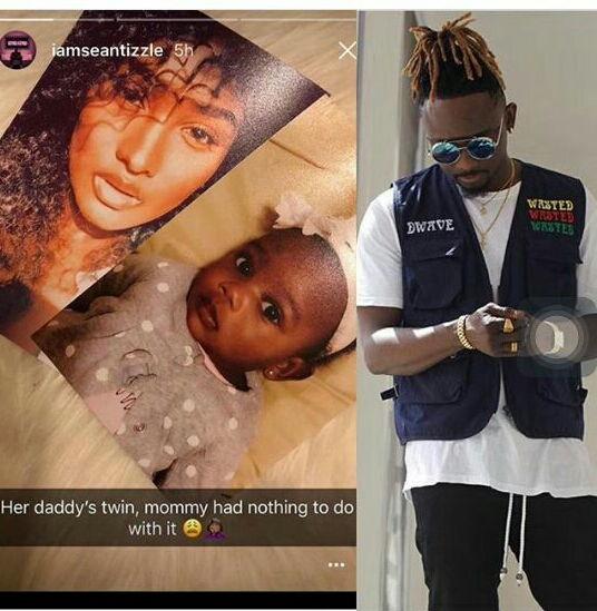 Sean Tizzle shows off his babymama and daughter