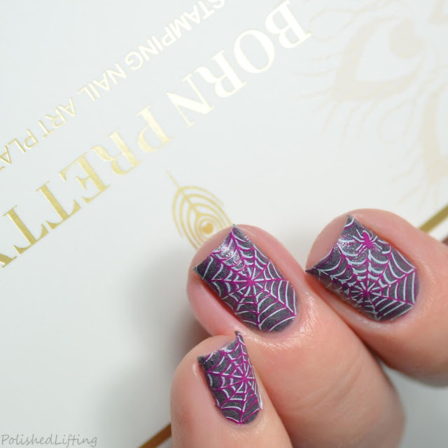 purple spiderweb nail art