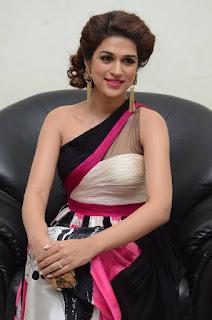 Actress Shraddha Das Latest Stills in Stylish Dress at tur Talkies Audio Launch  0031.jpg