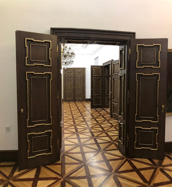 Wooden doors and parquet floor at the Pállfy Palace in Bratislava in Slovakia