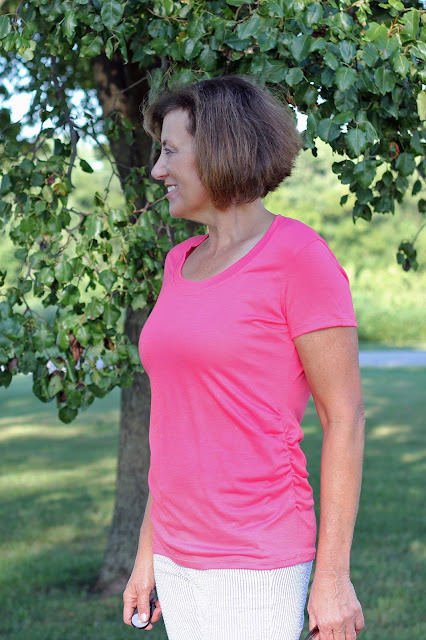 The Confident Stitch Rayon Lycra Coral knit made into Angela Wolf's Ruched T side view with ruching