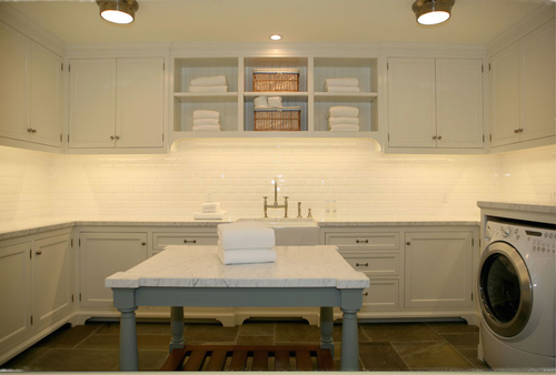 Gorgeous white cottage style laundry room by Giannetti Home