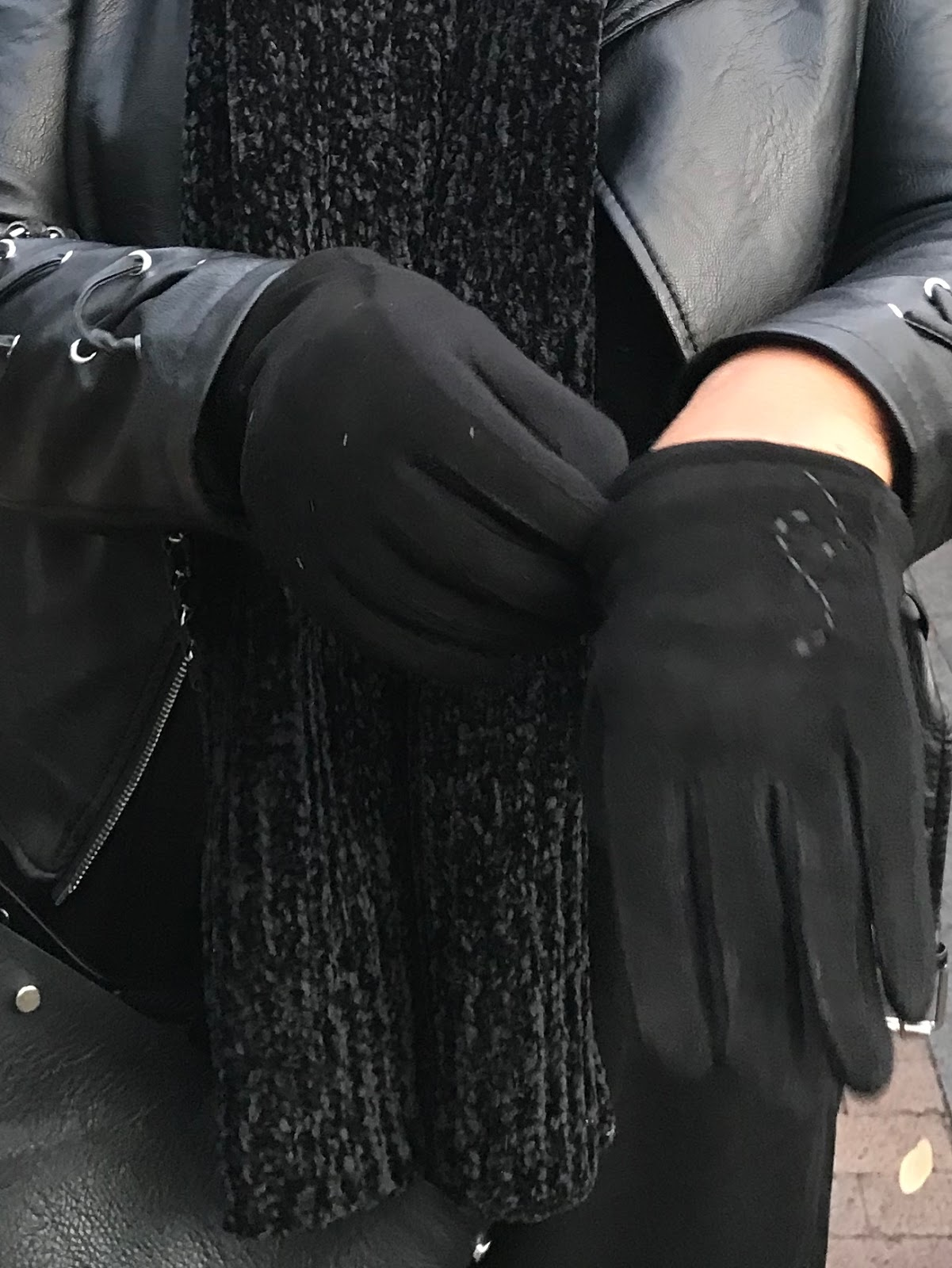 Image: Woman trying on black gloves