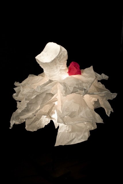 sculpted white paper dress with red paper rose at waist