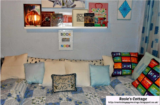 This gives us a bed for guests which can double as a very cozy book nook when the room is not being used for guests.