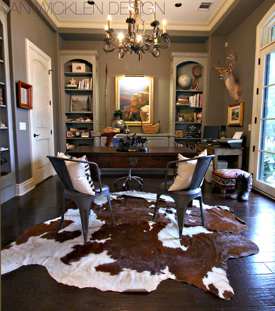 Cowhides Layered Over Natural Fiber Rugs
