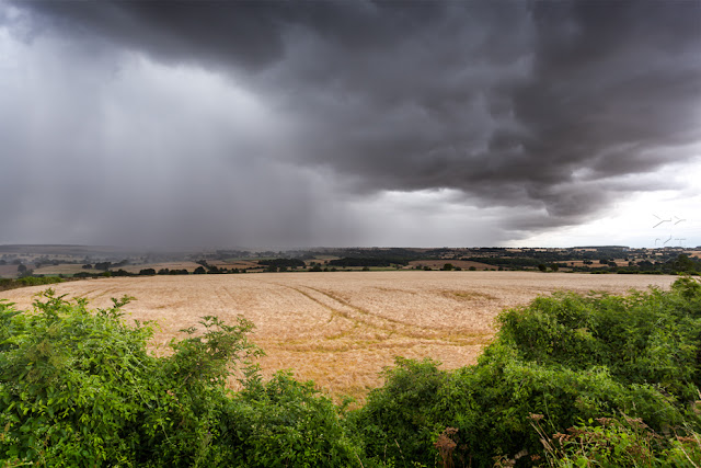 A storm front sweeps across the Cotswold landscape by Martyn Ferry Photography