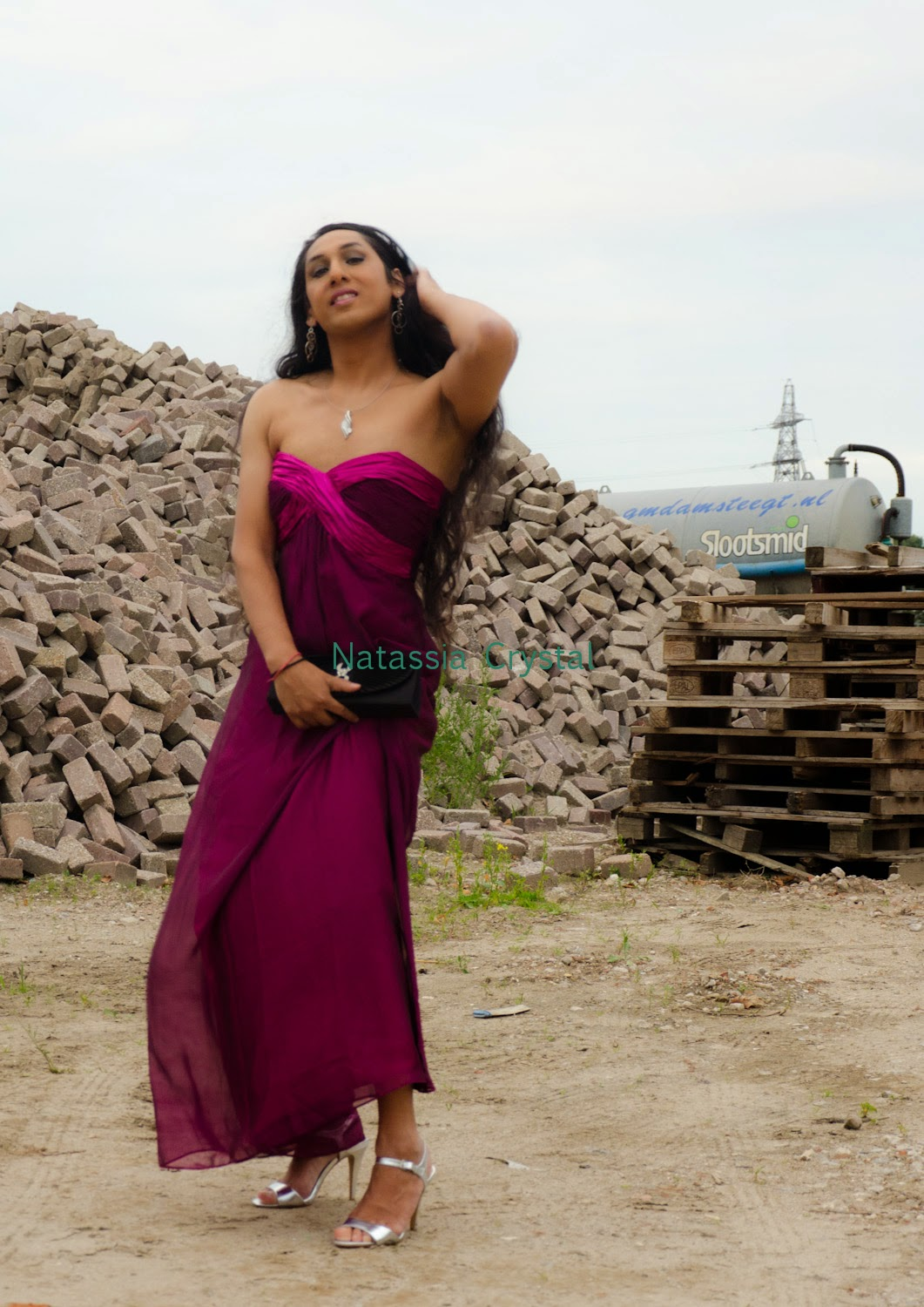 Natassia Crystal natcrys, long purple dress, outside posing in construction yard