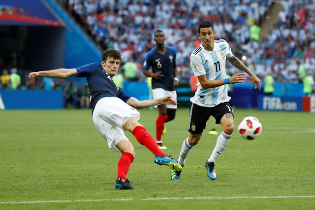 Pavard striking the ball for his sensational goal against Argentina