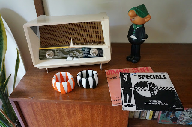 radiloa le corbusier 1958 orange white black bangles andy capp figure The Specials  - stéréotype / international Jet Set  Jimmy Cliff  - Wild world / be aware