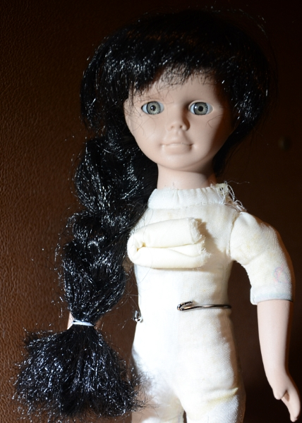 Porcelain doll before repaint.