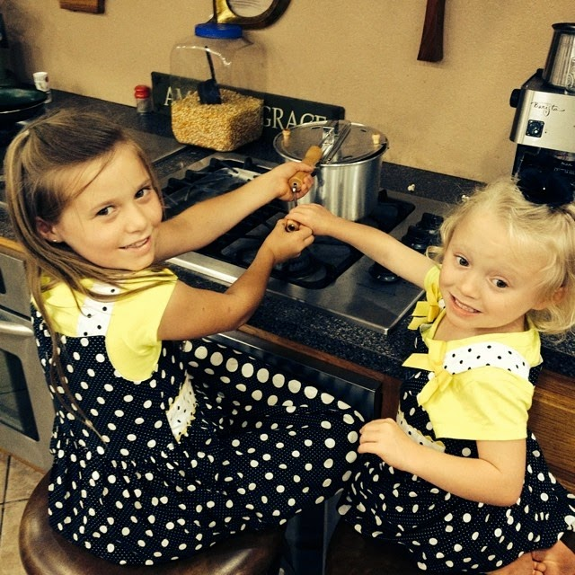 Johannah and Josie Duggar make popcorn
