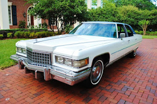 White 1976 Cadillac Fleetwood Brougham Front Left