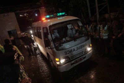 An ambulance carrying the body of one of the four executed drug convicts leaves Cilacap, Central Java on July 29, 2016