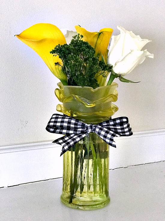 faux depression glass flower vase with flowers and bow