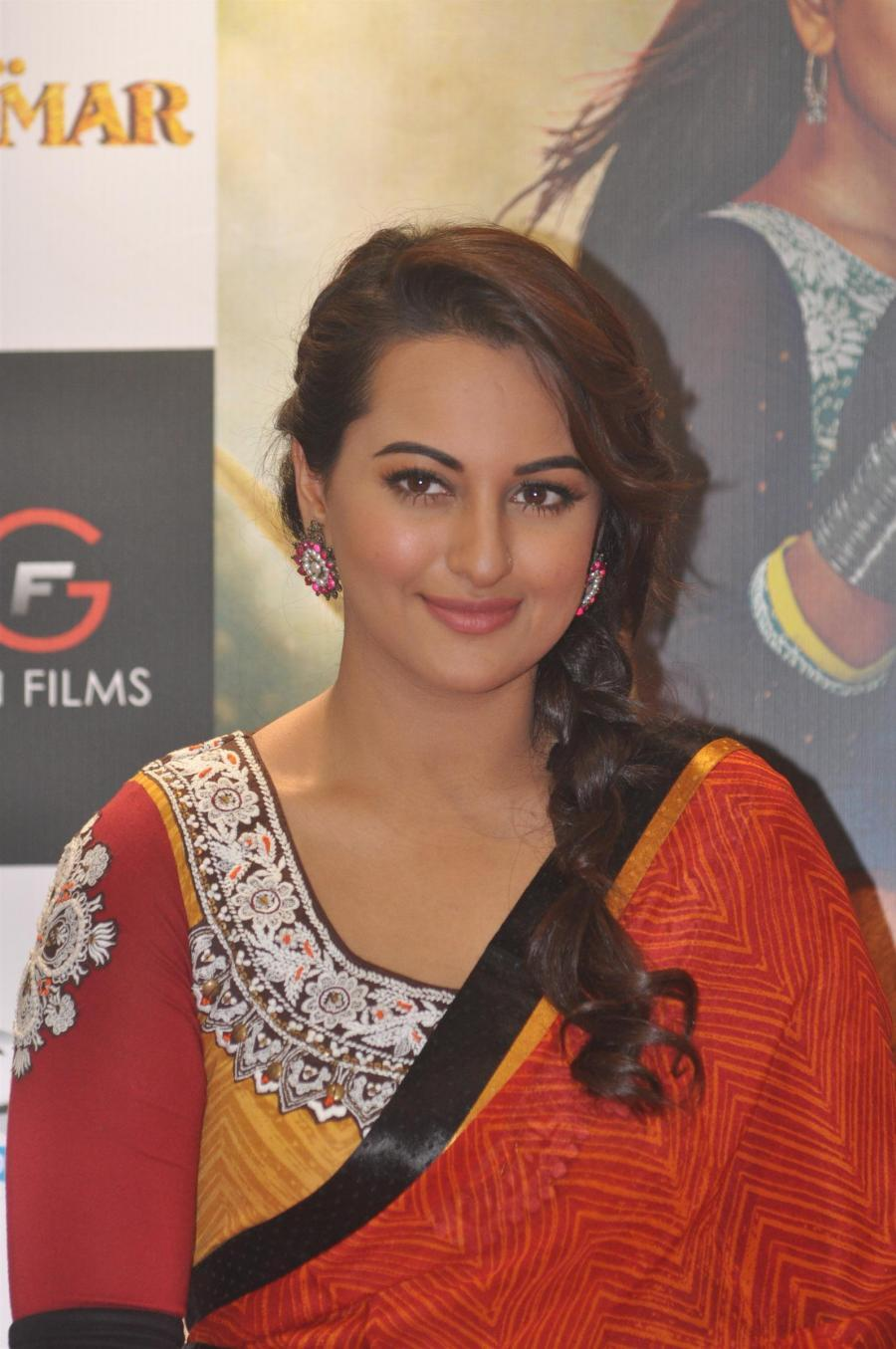 Model Long Hair Stills In Orange Saree Sonakshi Sinha