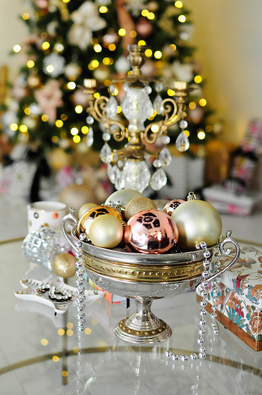 Vintage candle holder is the star of this coffee table decor vignette with blush, silver, gold and white accents.
