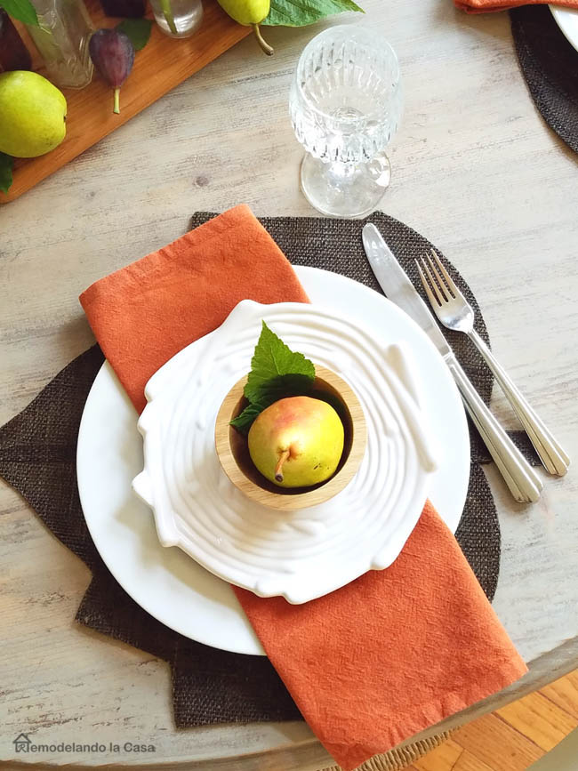 LOG salad plated, pear inside wooden bowl, rusty color napkin, wooden table