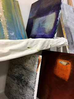 Image of paintings in storage rack