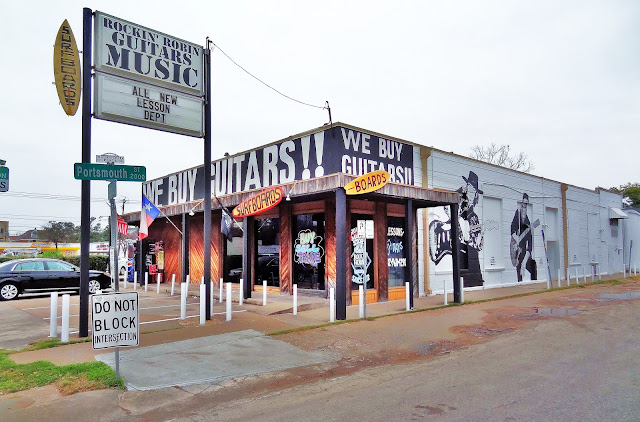 Rockin' Robin Guitars Music Store with Mural on side wall - Portsmouth Street in Montrose off South Shepherd