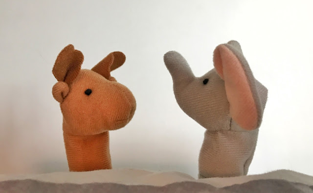 A deer and an elephant finger puppets